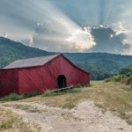 A barn in a mountain valley
